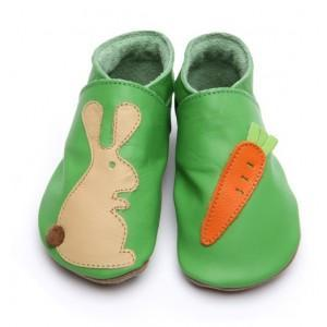 Rabbit and carrot on green