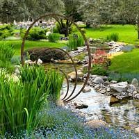 Sculpture de jardin ronde - Anneaux de fer concentriques